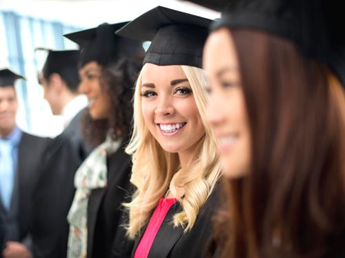 A row of graduates