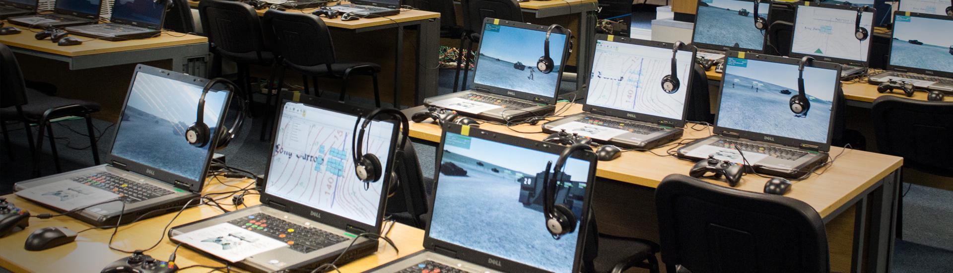 Computer laptops in work room